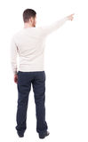 Back view of pointing business man. Royalty Free Stock Images