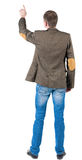 Back view of pointing business man in jacket Stock Photography