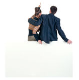 Back view of pointing business team with  empty billboard. Royalty Free Stock Photo