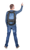 Back view of  pointing man with backpack looking up. Stock Photo