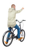 Back view of pointing man with a bicycle. Royalty Free Stock Image