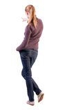 Back view of  pointing woman. beautiful blonde  girl in jeans Stock Photography