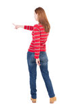 Back view of pointing woman. stock photography