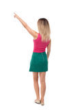 Back view of  pointing woman. beautiful girl. Royalty Free Stock Image