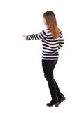 Back view of  pointing woman. beautiful girl. Royalty Free Stock Images
