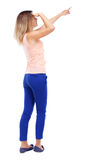 Back view of  pointing woman. beautiful girl. Royalty Free Stock Photography