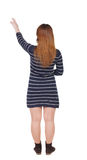 Back view of  pointing woman Stock Photos
