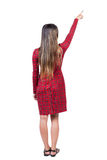 Back view of  pointing woman. beautiful girl. Royalty Free Stock Photo