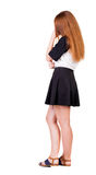 Back view of  pointing woman. beautiful redhaired  girl . girl s Royalty Free Stock Photos