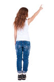 Back view of  pointing woman Stock Photo