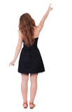 Back view of  pointing woman. Stock Image