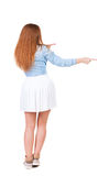 Back view of  pointing woman. Stock Photo