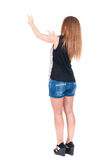 Back view of  pointing woman Stock Image