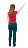 Back view of  pointing woman. Stock Images
