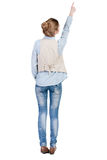 Back view of  pointing woman in vest. Royalty Free Stock Images