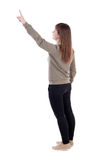 Back view of  pointing woman. Stock Photos