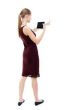 Back view of pointing young beautiful  girl with tablet computer Stock Photos