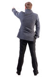 Back view of  pointing young business men in  coat Royalty Free Stock Photos