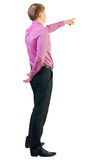 Back view of  pointing young business men in  pink shirt. Royalty Free Stock Photos