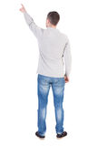 Back view of  pointing young man Stock Photography