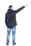 Back view of  pointing young man in parka. Stock Images