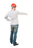 Back view of  pointing young men in helmet. Royalty Free Stock Photos