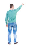 Back view of  pointing young men Royalty Free Stock Photo