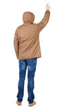 Back view of  pointing young men in parka. Stock Photos