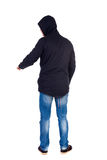 Back view of  pointing young men in parka. Royalty Free Stock Photography