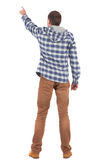 Back view of  pointing young men in  plaid shirt with hood Stock Photo