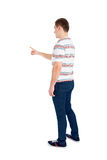 Back view of pointing young men. Rear view people collection. Royalty Free Stock Photography