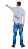 Back view of  pointing young men in  shirt and jeans Stock Photography
