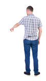 Back view of  pointing young men in  shirt and jeans. Stock Photography