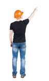 Back view of  pointing young men in  t-shirt and helmet. Stock Photography