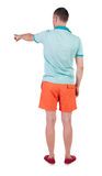 Back view of  pointing young men in  t-shirt and shorts. Stock Photography