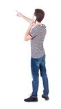 Back view of  pointing young men talking on cell phone. Stock Image
