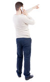 Back view of  pointing young men talking on cell phone. Stock Images