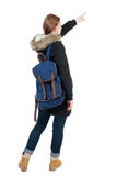 Back view of  pointing young women in parka. Stock Image
