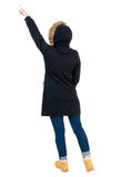 Back view of  pointing young women in parka. Stock Photography