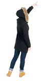 Back view of  pointing young women in parka. Royalty Free Stock Photography
