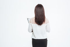 Back view portrait of a businesswoman standing with clipboard royalty free stock photo