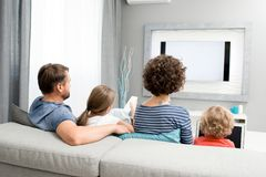Family Watching TV in Living Room royalty free stock photography