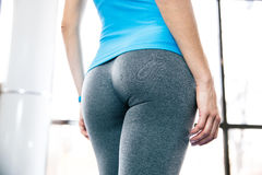 Back view portrait of female body. At gym Royalty Free Stock Images