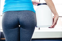 Back view portrait of female body at gym Royalty Free Stock Photos