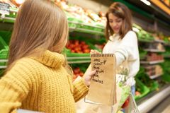 Little Girl Helping Grocery Shopping stock photo