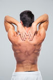 Back view portrait of a man with neck pain Stock Photos