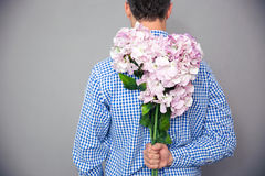 Back view portrait of a man standing with flowers Royalty Free Stock Image