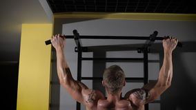 Back view portrait of a muscular man tightening in The Gym's Studio stock video footage