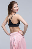 Back view portrait of a smiling sports woman Stock Images