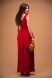Back view portrait of a trendy woman in red dress Royalty Free Stock Images